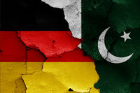 flags of Germany and Pakistan painted on cracked wall