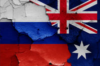 flags of Russia and Australia painted on cracked wall