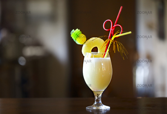 Pina Colada. Yellow alcohol cocktail with pineapple, lemon, cold vodka filled with crushed ice in a beautiful cocktails glass