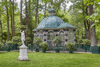 Statue and garden house at Peterhof Gardens close to St. Petersburg in Russia