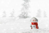 Snowman toy on winter background