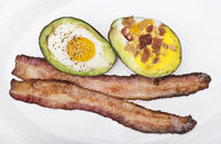 Baked avocado with eggs , cheese and bacon