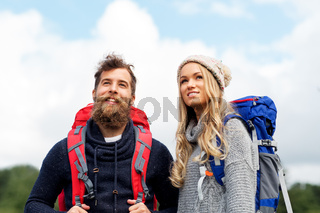 couple of travelers with backpacks hiking