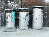 Dustbins in dirty environment. Pollution concept.