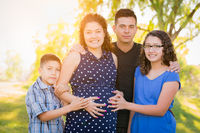 Hispanic Pregnant Family Portrait Outdoors