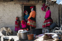 October 21, 2012 - Maras, Urubamba Valley, Peru : Quechua Indian Woman And Her Family Dressed In Colorful Handwoven Outfit And Standing Outside Their House