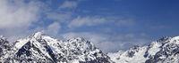Snowy rocks at sunny winter day