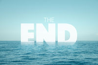 the end text in water with ocean background - climate change concept