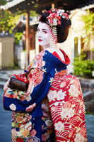 Woman as maiko geisha on a street of Gion in Kyoto Japan