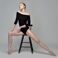 Beautiful gymnast woman sitting on chair in studio