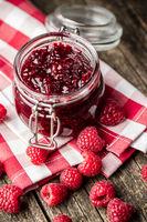 Sweet raspberry jam and raspberries.