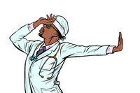 african doctor man medicine. shame denial gesture no