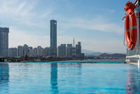 Skyline of the city of Xiamen from infinity edge swimming pool