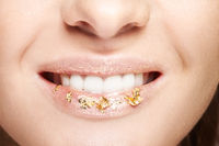 Female mouth with sparkles on lips. Closeup macro beauty portrait of young woman face