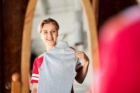 teenage girl at vintage clothing store mirror