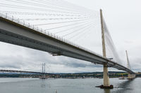 The new Queensferry Crossing bridge over the Firth of Forth with the older Forth Road bridge in Edin