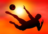 Soccer player on sunset background