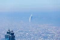 Skyline of Dubai beachfront with Burj Al Arab hotel on Jumeirah beach seen from Burj Khalifa viewpoint.