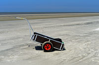 Handcart in the wadden sea at low tide, Wadden Sea National Park, Westerhever, Germany