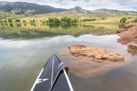 stand up paddleboard on a mountain lake