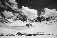 Black and white plateau in mountains with frozen lake