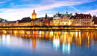 Luzern Kapelbrucke and riverfront architecture famous Swiss landmarks panoramic view