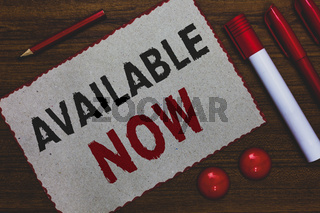 Conceptual hand writing showing Available Now. Business photo showcasing Handy Eligible Today Present Bachelor Here on Board Accessible White paper red borders markers pencils wooden background.