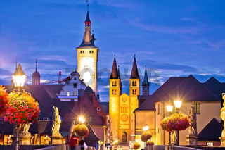 Old Main Bridge over the Main river and scenic towers in the Old Town of Wurzburg dawn view