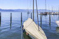 Moored sailing yacht in the harbor of Lindau island, Lake Constance, landscape picture