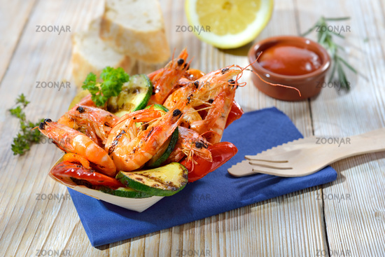 Portion grilled prawns with vegetables
