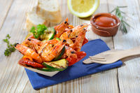 Portion grilled prawns with vegetables