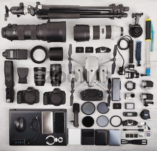 top view of complete photographer professional equipment