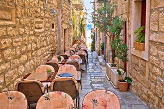 Narrow stone restaurant street in old Mediterranean town of Korcula