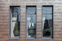 The windows of the store, which are mannequins in fashionable clothes.