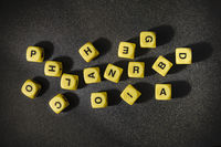 Letters Game Cubes over Black Background
