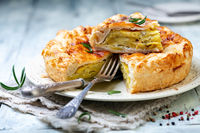 Puff pastry pie dish with potatoes and rosemary.