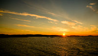 Sunset and sunrise over the sea and Lofoten archipelfgo from the Moskenes - Bodo ferry , Norway