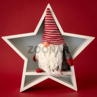 Christmas decoration white star with a gnome inside