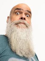skeptical looking bearded man