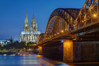 The Cologne Cathedral and the Hohenzollern railway bridge after sunset