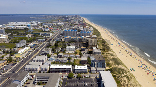 People Flock to the Beach on a 90 plus degree day in Ocean City Maryland