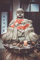 Jizo statue in Arashiyama temple, Kyoto, Japan