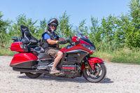 Senior motor biker Honda Goldwing making a drive through Hungary
