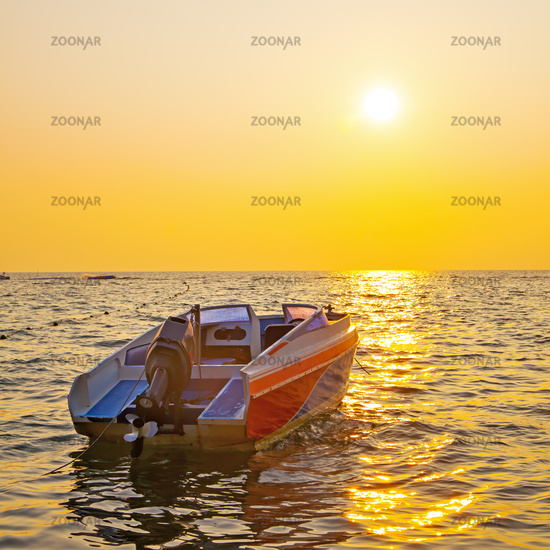 Sea and boat at sunset