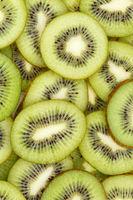 Kiwi fruits collection food background portrait format slices kiwis fresh fruit