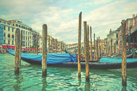 Grand Canal near Rialto bridge in Venice with moored gondolas