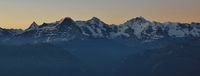 Famous mountains Eiger, Monch and Jungfrau at sunrise.