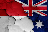flags of Indonesia and Australia painted on cracked wall