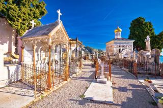 Historic graveyard in town of Menton walkway view