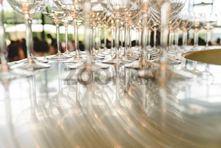 Group of empty transparent glasses ready for a party in a bar.